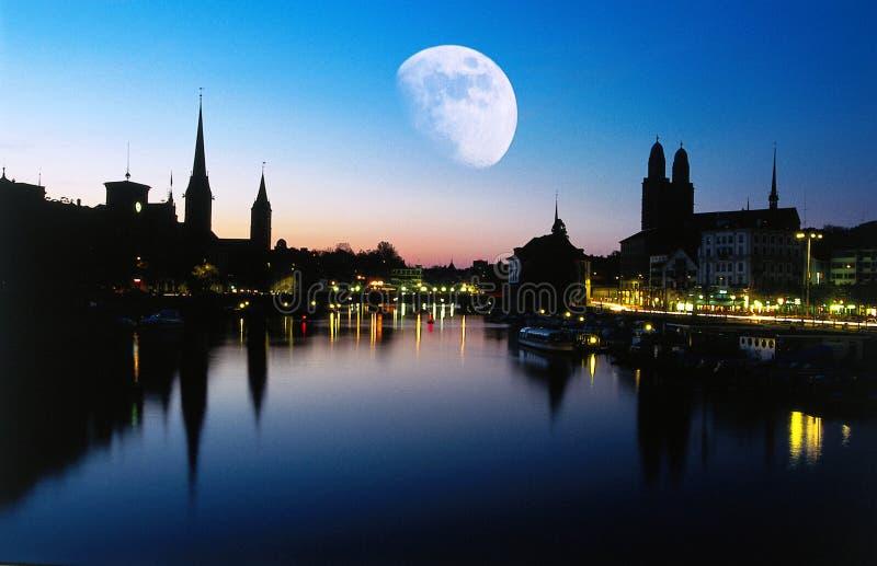 Moon at dusk, Zurich stock photo