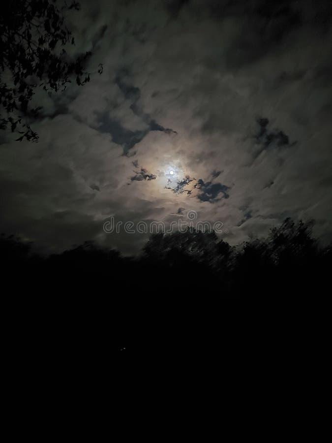 Moon from earth. Night, dark, hallowren, omniscient, ominously, street, streetshot, fullmoon royalty free stock photography