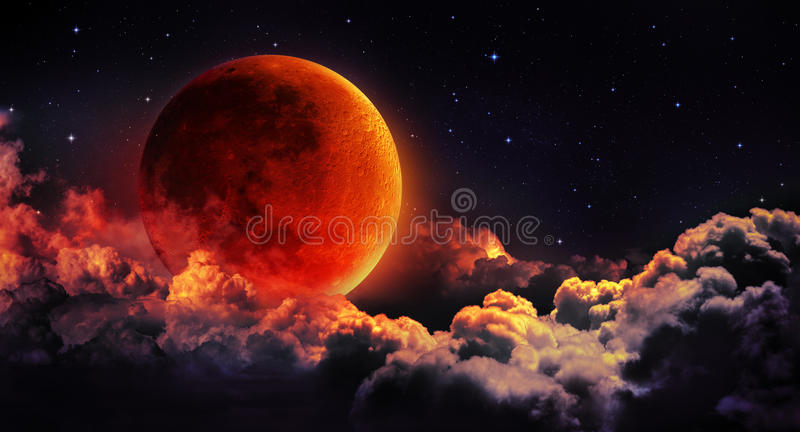 Moon eclipse - planet red blood. With clouds stock images