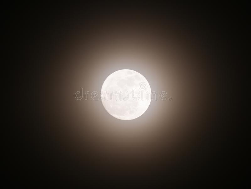 Moon Emitting Light with Halo stock images
