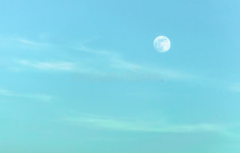 The moon in the evening sky royalty free stock image