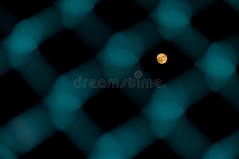 Moon through the fence stock photos