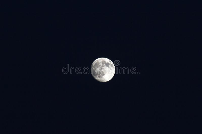 Moon. The Moon (Greek: Σελήνη, Selene; Latin: Luna) is Earth's only natural satellite. It is one of the largest natural satellites in the Solar stock image