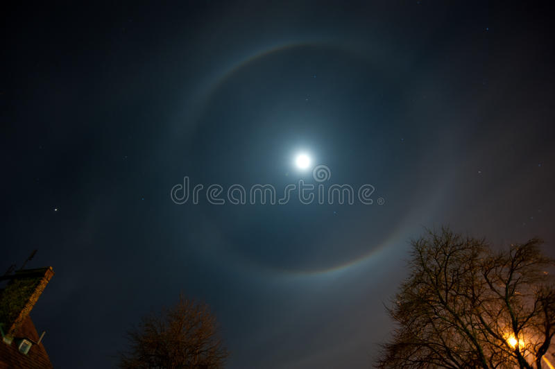 Moon halo. Phenomenon. Bright ring around the moon effect. Amazing and mysterious astronomical phenomenon over the night sky royalty free stock photo