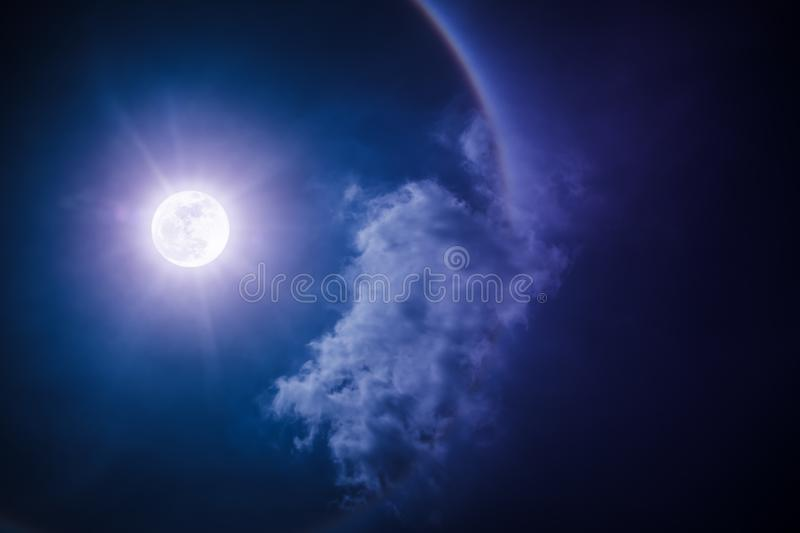 Moon halo phenomenon. Nighttime sky and bright full moon with sh. Moon halo phenomenon. Beautiful night landscape of dark sky and bright ring around the moon stock images