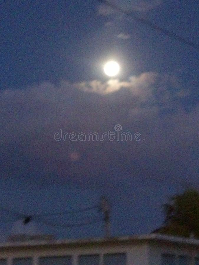 Moon hiding. At home in portmore st catherine jamaica royalty free stock images