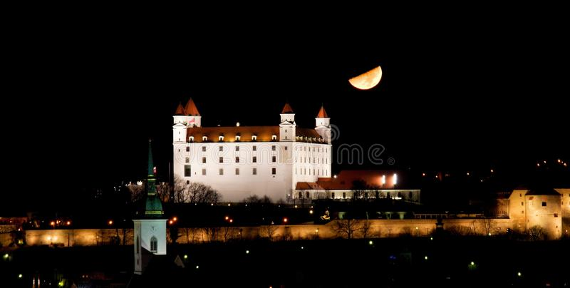 Download Moon And Illuminated Bratislava Castle Stock Photo - Image: 83712071