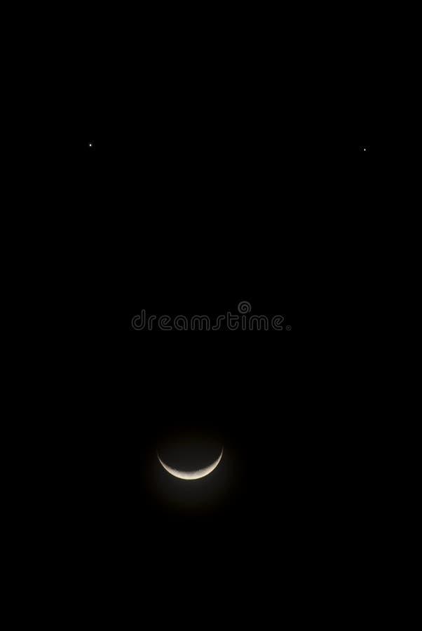 Moon, jupiter and venus meet stock images