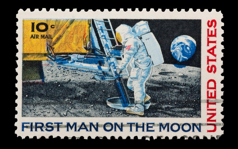 Moon landing. Mail stamp printed in the U.S.A commemorating the first manned landing on the moon, circa 1969 stock photos
