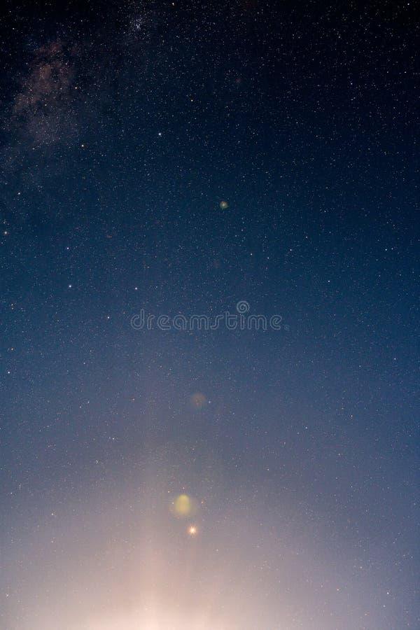 Moon lens flare stary sky stock image