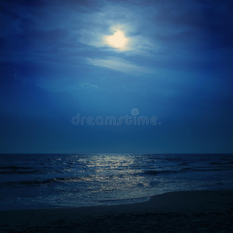 Moon light in dark sky over sea stock images