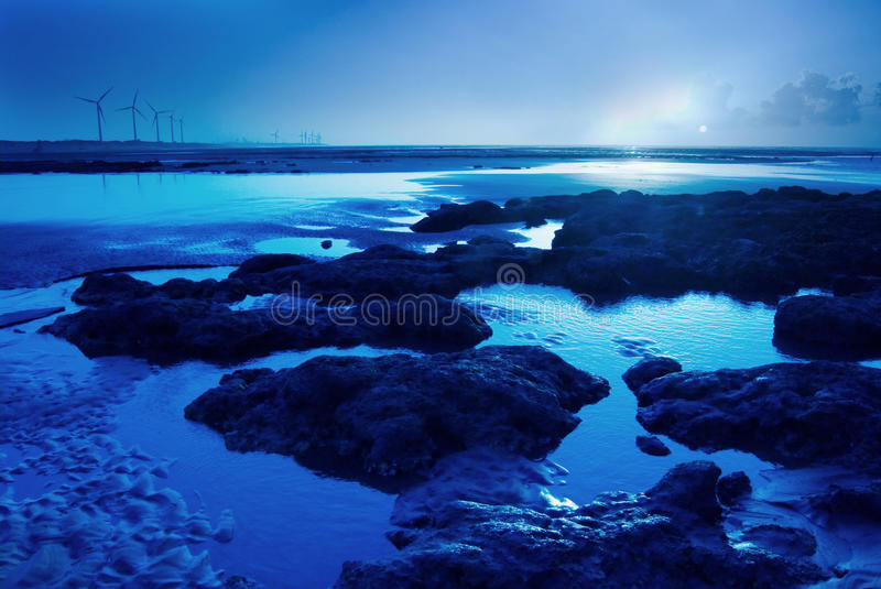 Moon light on the rock seacoast. With reflection royalty free stock photos