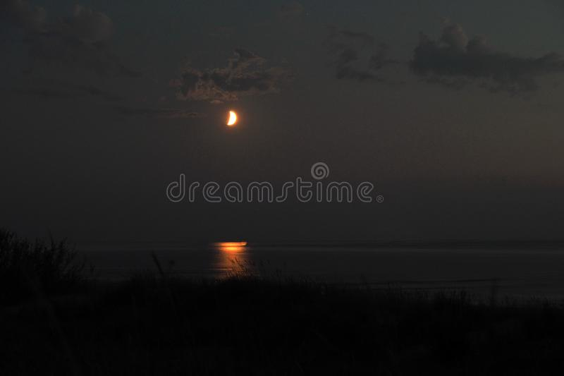 Moon lights and clouds after sunset royalty free stock photos