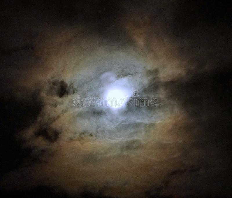 Moon after lunar eclipse and blue clouds royalty free stock photography