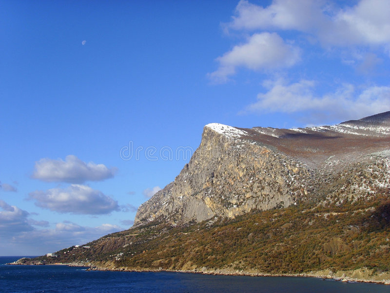 The Moon on mountain Coosh-Cue daytime. Mountain Coosh-Cue by autumn, top in snow, moon daytime stock photos