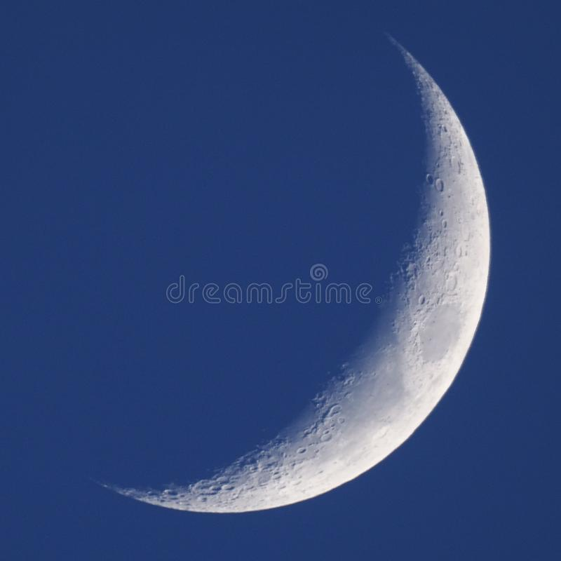Moon on night sky over telescope royalty free stock photo