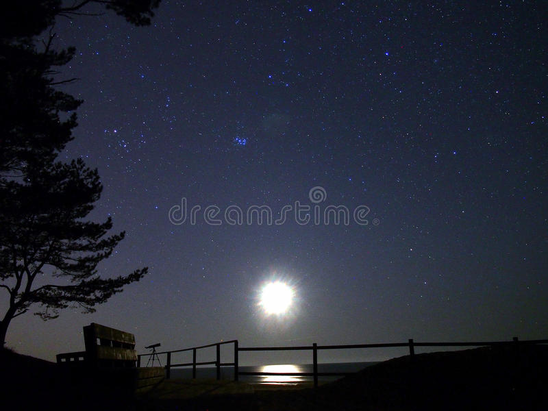 Moon light and stars observing royalty free stock photography