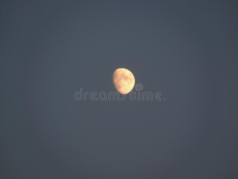 The moon in the July sky. stock photos