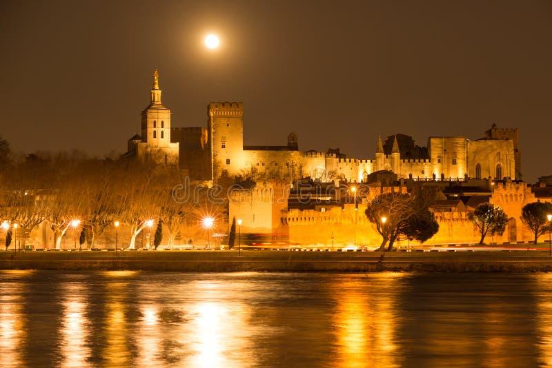 Moon over Avignon walls stock image