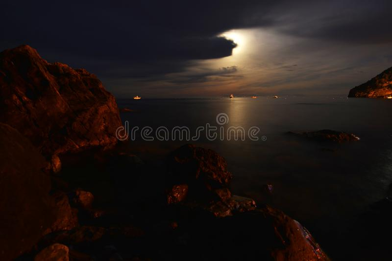 Night landscape. Moon over blue water. Night landscape royalty free stock images