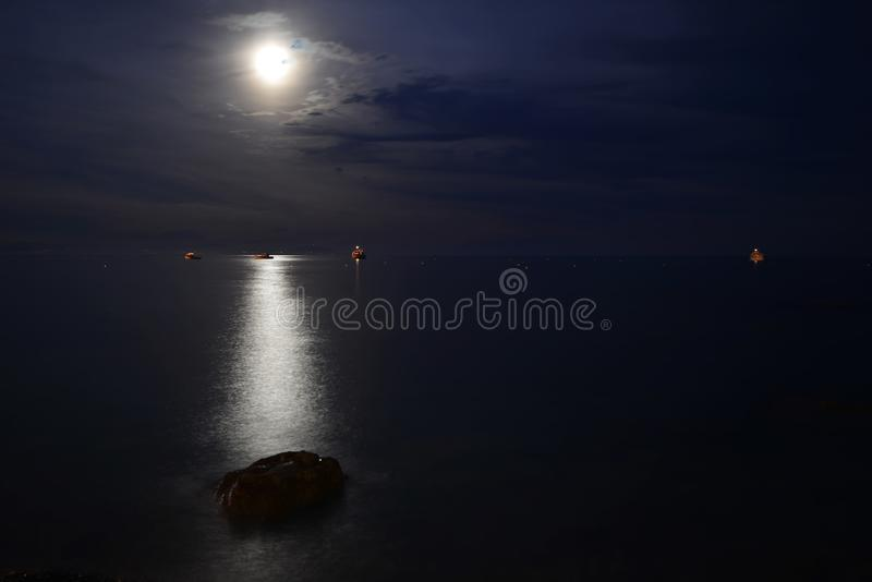 Night landscape. Moon over blue water. Night landscape royalty free stock photo
