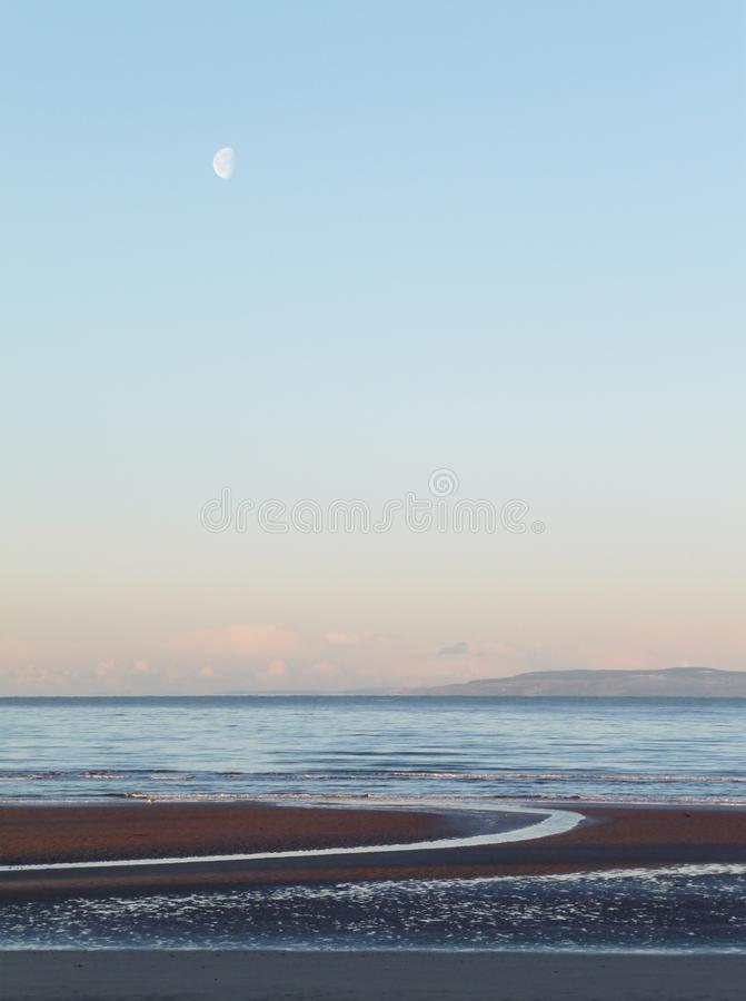 Moon over the Firth of Clyde, from Prestwick Beach, Scotland stock photography