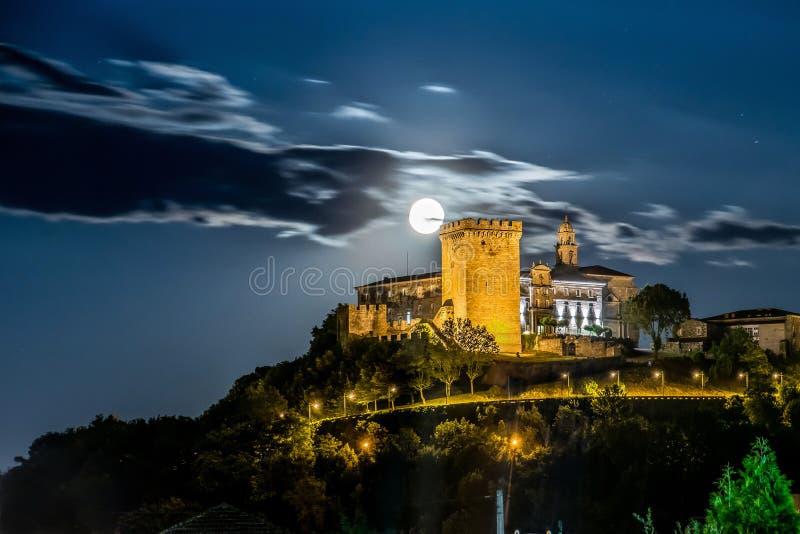 Moon over Monforte de Lemos castle at night stock images