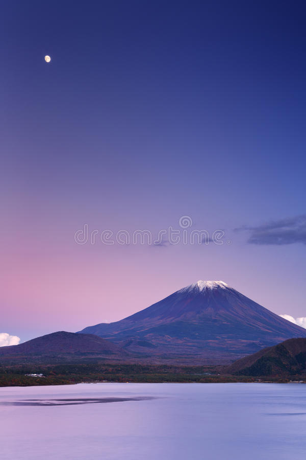 Moon over Mount Fuji and Lake Motosu in Japan royalty free stock photos