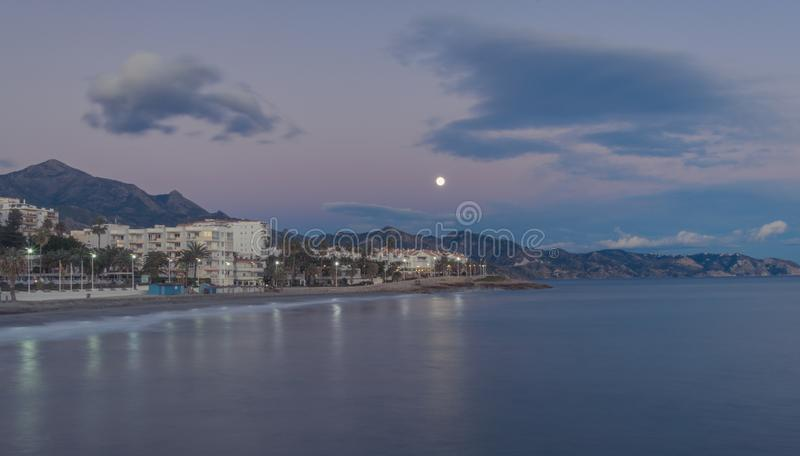 Moon over Nerja, southern Spain stock images