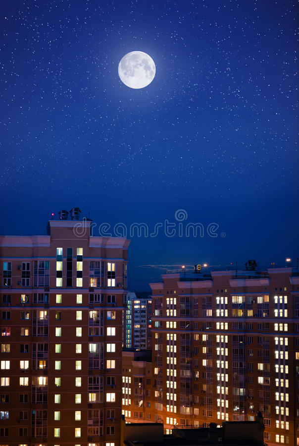 Moon over night city stock images