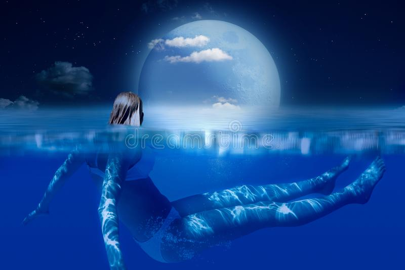 Moon over the night ocean, moonlight, girl in the water royalty free stock photography