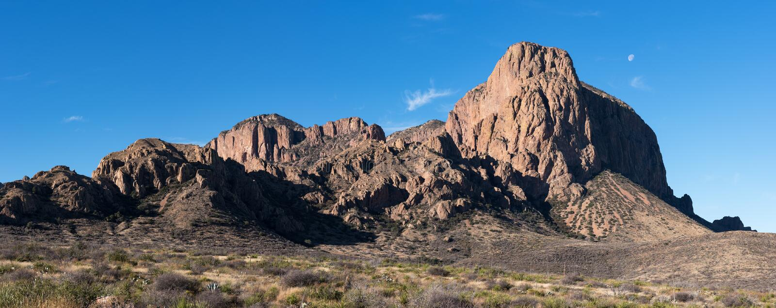 Moon over part of Chisos Mountain Range located within Big Bend National Park, Texas. Panorama of part of the Chisos Mountains located within Big Bend National royalty free stock image