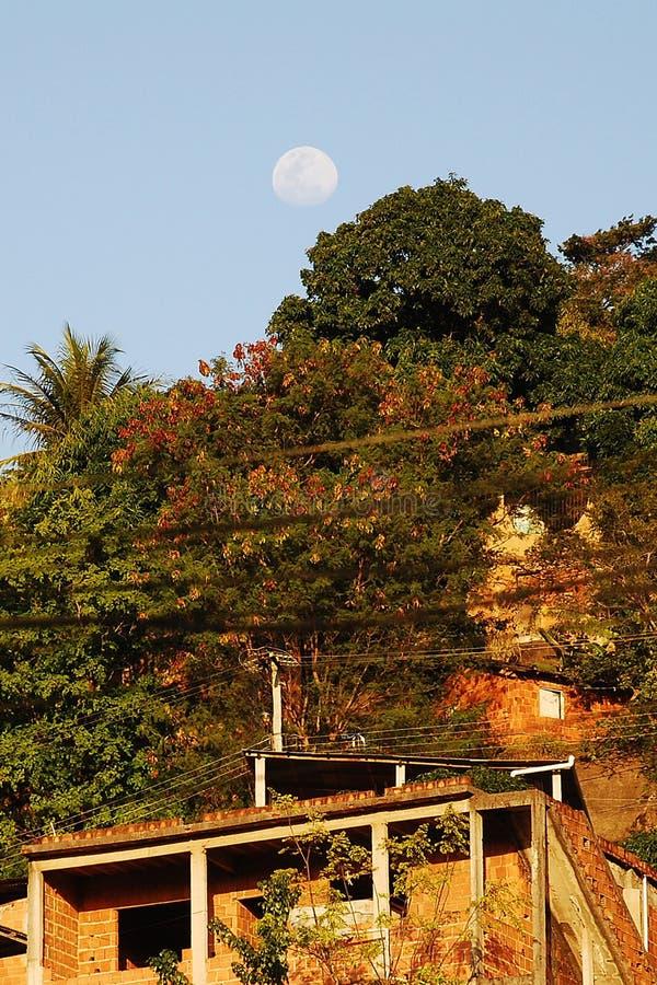 Moon over Poor Neighborhood in Brazil. 2010 - Vitoria-ES, Brazil. Moon over Poor Neighborhood in Brazil. Photo: Marco Franco royalty free stock image