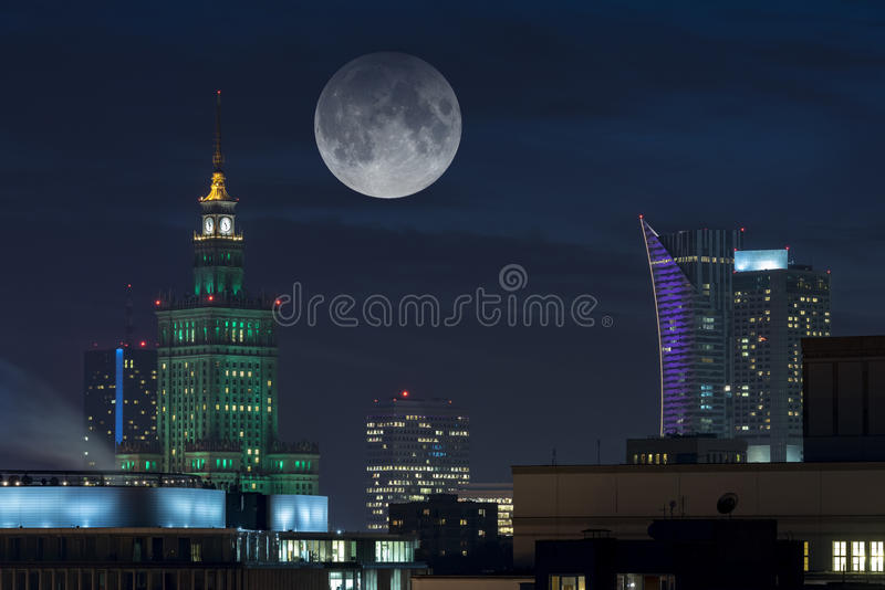 Moon over Warsaw city. Full moon over Warsaw city a capital of Poland stock photos