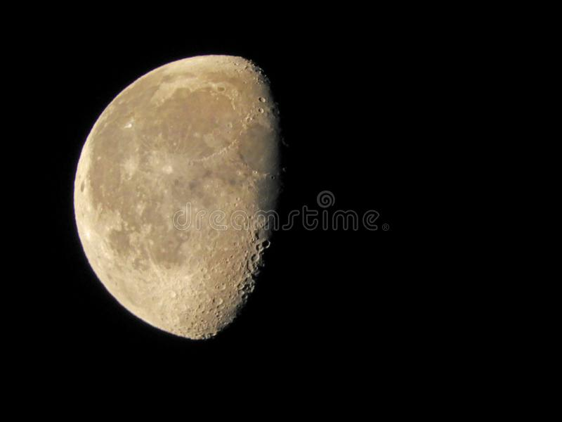 Moon Phase Waning Gibbous 52 percent 5.24.19. The Moon appears to be a circular disk which, at any specific time, is illuminated to some degree by the Sun stock photo
