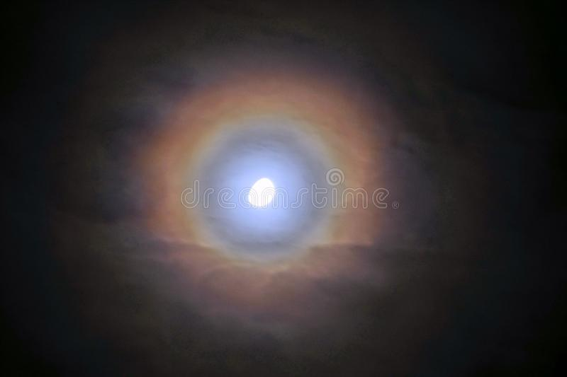 Moon rainbow and clouds observing on sky stock photography