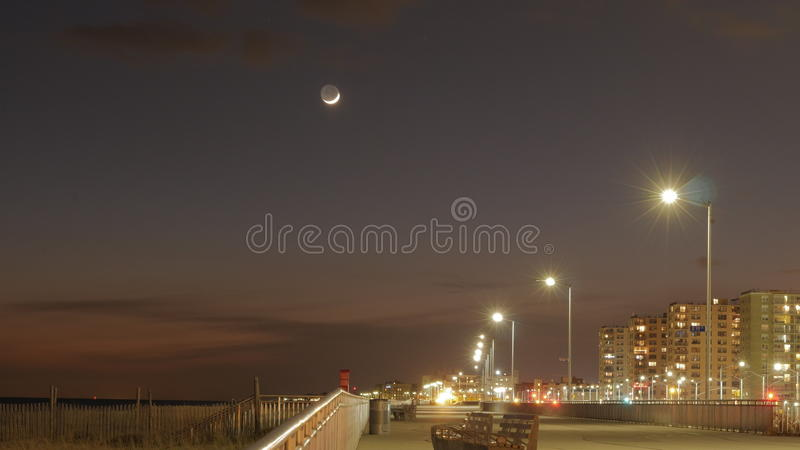 Moon right after the sunset royalty free stock photo