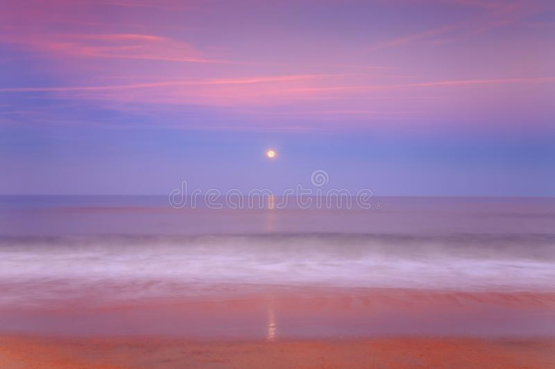 Moonrise over the ocean royalty free stock images