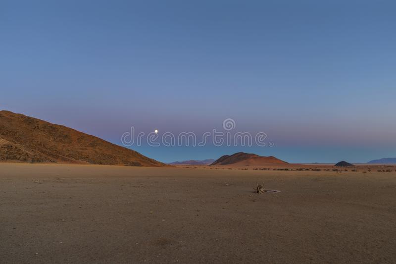 Moon rise at sunset. Namibia royalty free stock photos