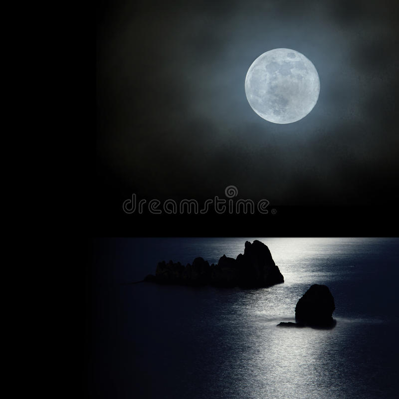 The moon rise up over the ocean royalty free stock image