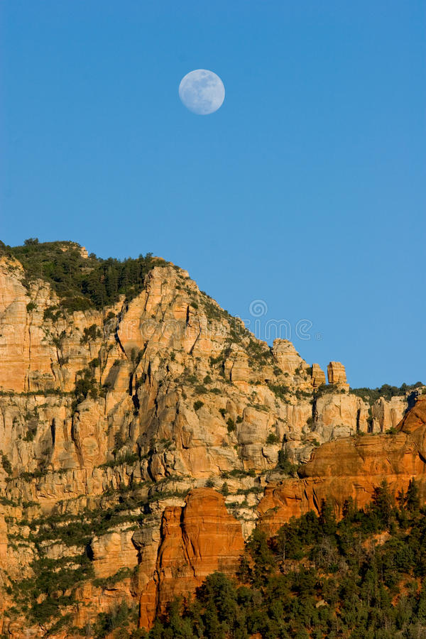 Moon rises over mesas and buttes near Sedona, Arizona. USA royalty free stock image