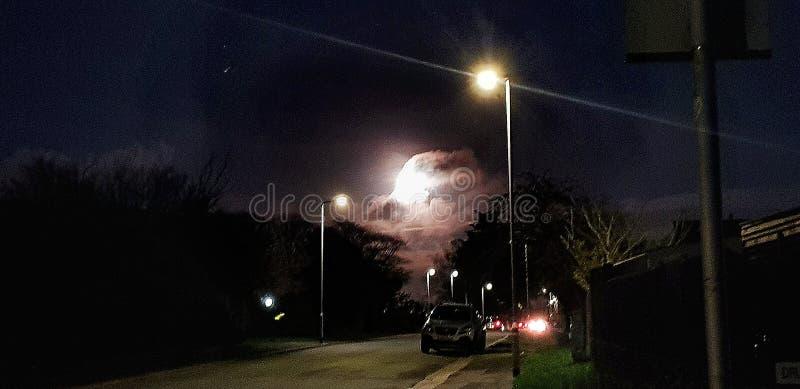 Moon Rises Over a Suburban Rd Plymouth stock photos