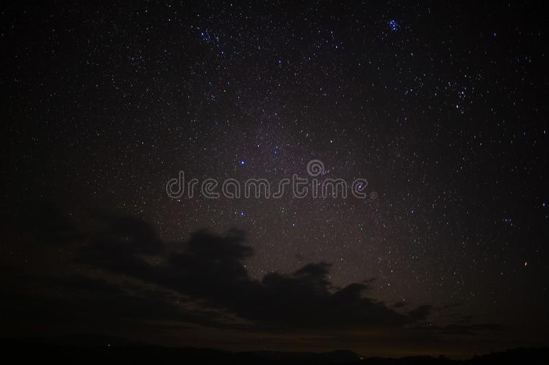 The moon is rising in the sky with stars. The moon is rising brightly in the sky with stars stock photos