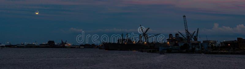 Moon rising over Inner Harbor stock photo