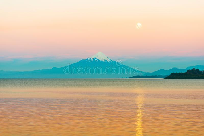 Moon rising over Lake LLanquihue and Osorno Volcano. X Region de Los Lagos, Chile royalty free stock images