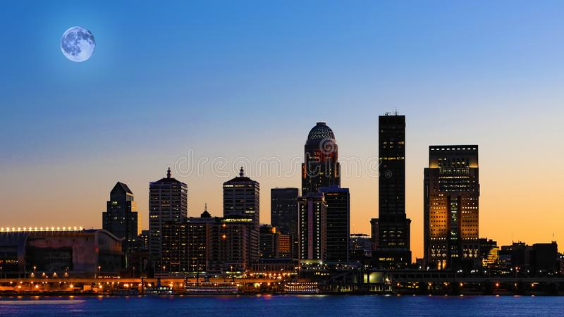 Moon rising over Louisville, United States. A Moon rising over Louisville, United States royalty free stock photos