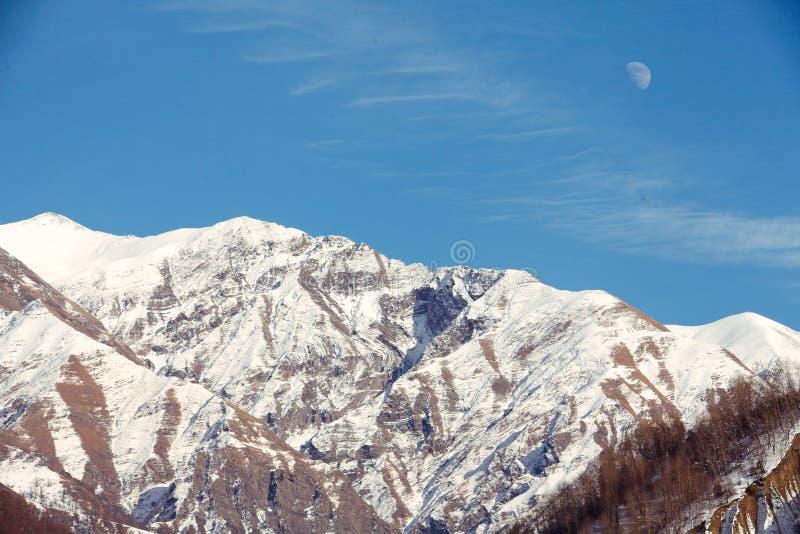 Moon rising over mountain royalty free stock photo