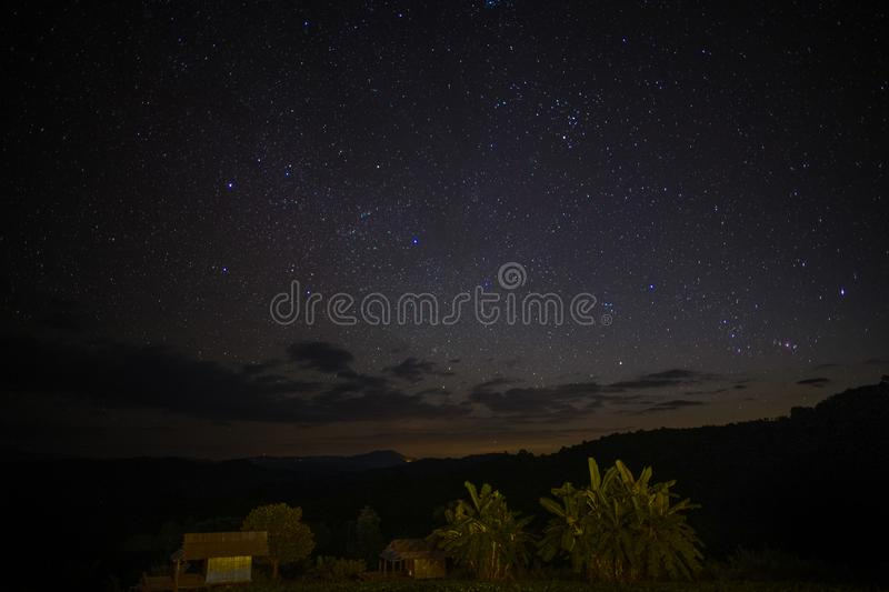 The moon is rising in the sky with stars. The moon is rising brightly in the sky with stars royalty free stock photos