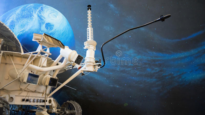 Moon Rover. A lunar rover or moon rover in space with the earth and the stars on the background