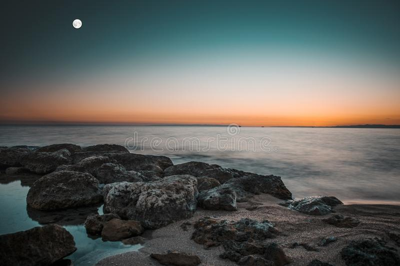 Moon on the sea royalty free stock photo